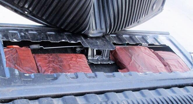 Officers discovered packages of marijuana when they peeled back the bedliner of a smuggling vehicle
