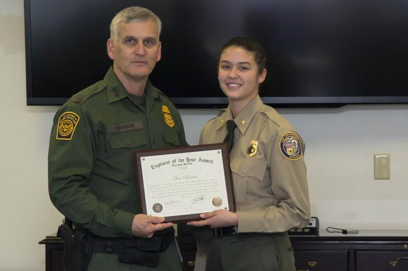 Tucson Sector Chief Patrol Agent Paul Beeson congratulates Ana Barrios, 16, on being selected the first Explorer of the Year for the Tucson Sector