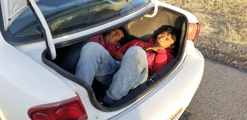 Agents stopped a vehicle, which turned out to be carrying two people in the trunk