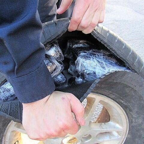 Smugglers attempted to hide meth within the spare tire and spare tire storage area
