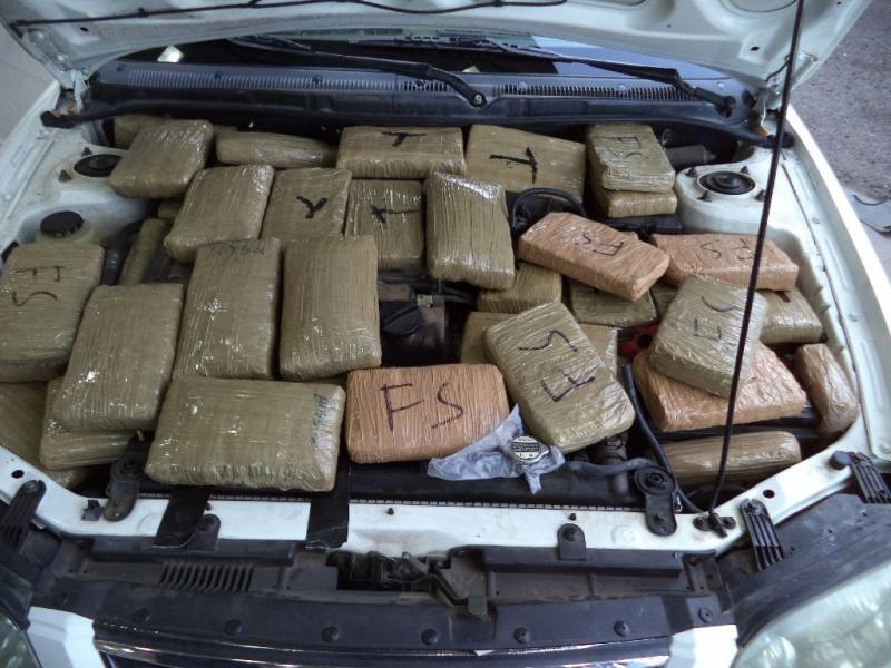 Packages of marijuana were scattered underneath the hood of a smuggling vehicle stopped and seized by CBP officers in Douglas, Ariz.