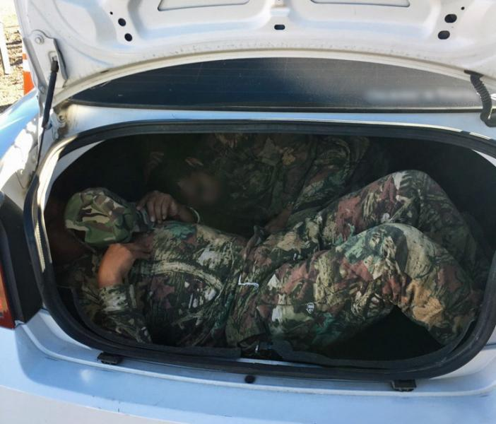 agents discovered two illegal aliens inside of the trunk of a vehicle