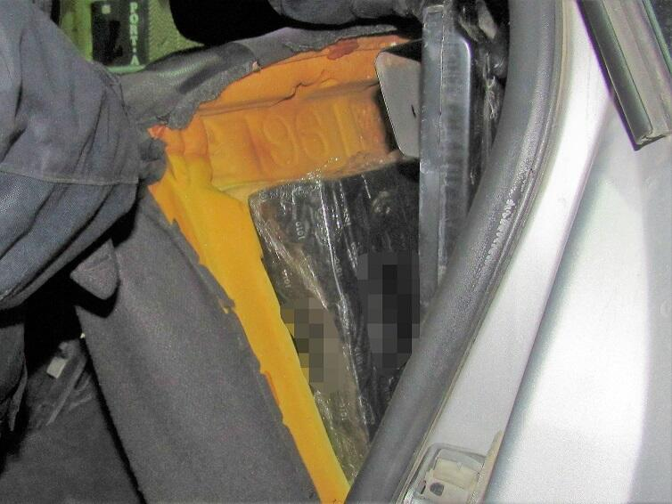 Officers located packages of meth within the quarter panels of a smuggling vehicle
