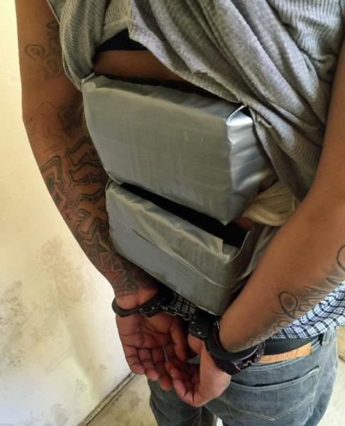 When CBP officers searched a border crosser, they found a combination of heroin and cocaine strapped to his back