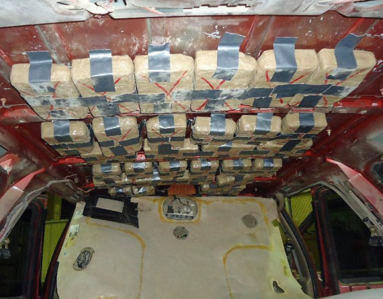Officers seized 370 pounds of marijauna from throughout a smuggling vehicle, including from within the ceiling