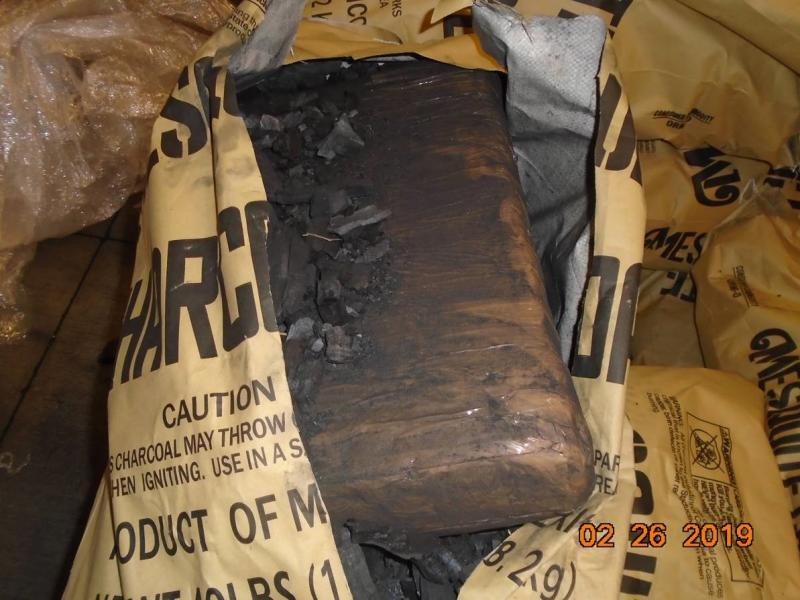 A CBP canine alerted officers to bundles of marijuana within a shipment of charcoal