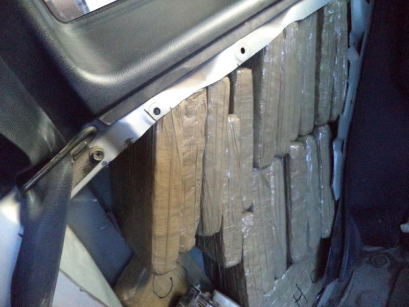 Drug smugglers attempted to conceal marijuana within the quarter panels and cowling of a vehicle that was caught by CBP officers in southeastern Arizona