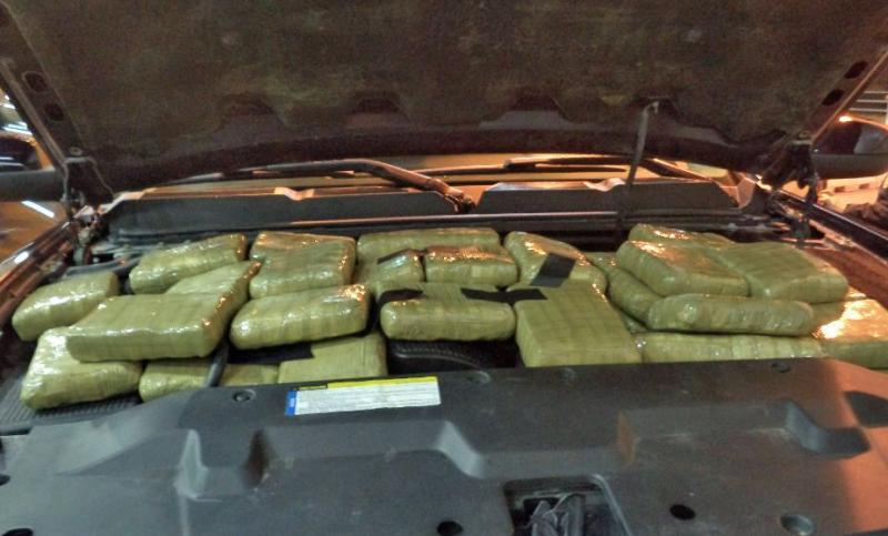 CBP officers at the Port of Douglas located and seized 182 packages of marijuana from underneath the hood of a smuggling vehicle