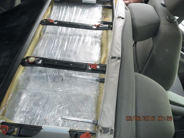 CBP officers removed packages of marijuana from within the seats of a smuggling vehicle