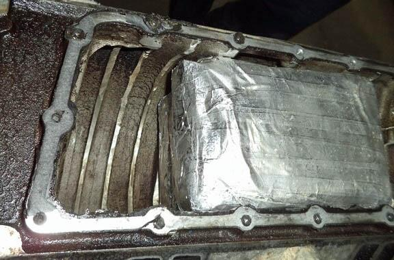Officers discovered more than 10 pounds of heroin within the intake manifold of a smuggling vehicle