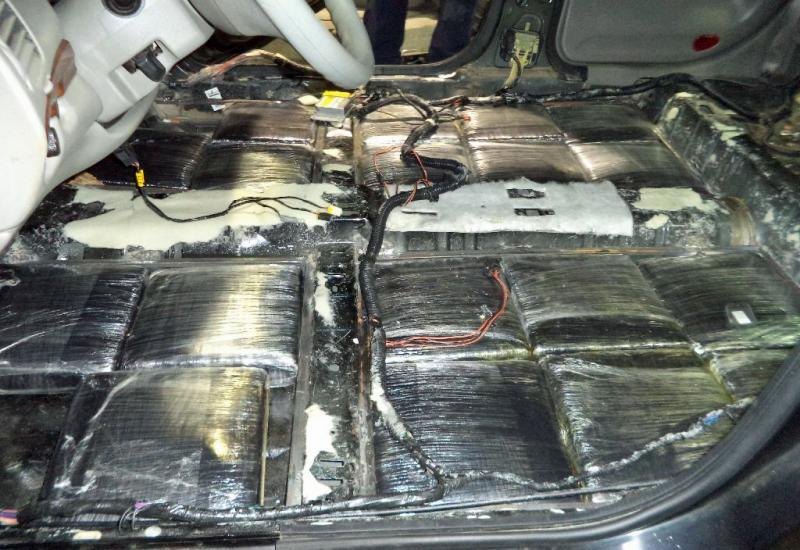 Nearly 114 pounds of marijuana are seized from the floorboards of a smuggling vehicle at the DeConcini crossing