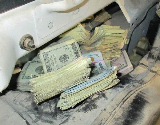 Officers discovered $38,000 worth of unreported currency inside of a quarter panel in a smuggling vehicle