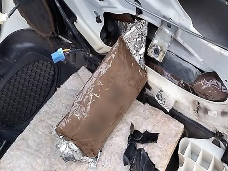Smugglers attempted to hide cocaine within the door panels and firewall of a smuggling vehicle