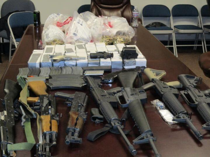 An assortment of weapons, and accessories were removed from the vehicle of a Mexican woman