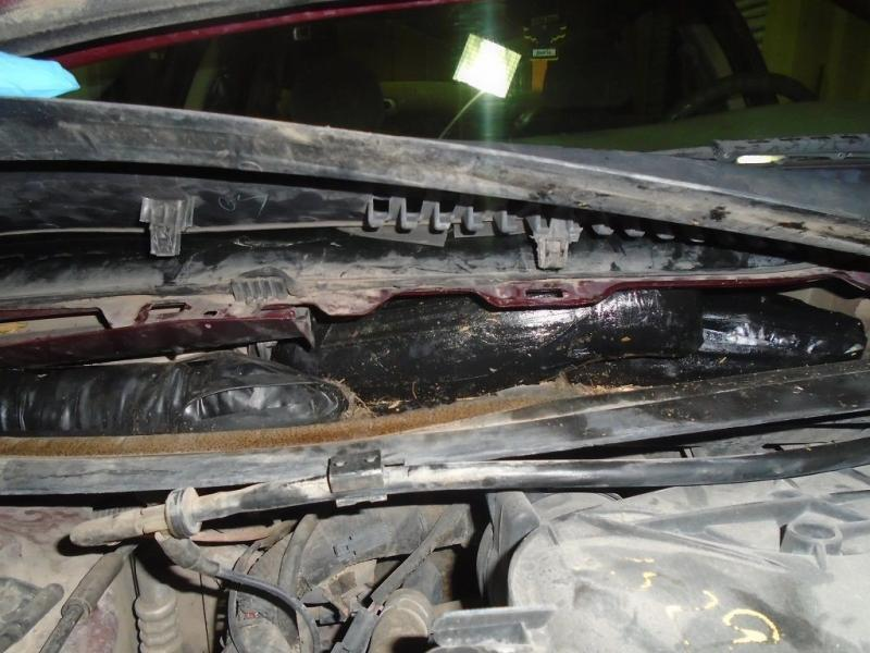 Officers were led to the firewall of a smuggling vehicle by a CBP canine, where they removed a combination of heroin and meth