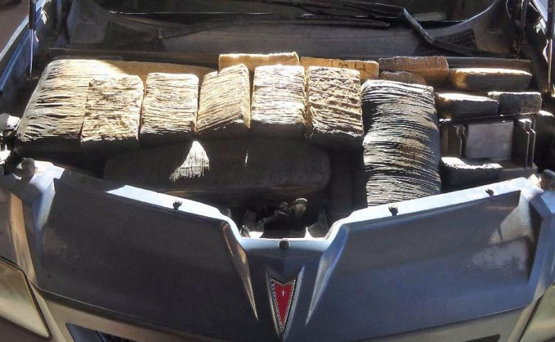Officers were led to discover more than 200 pounds of marijuana