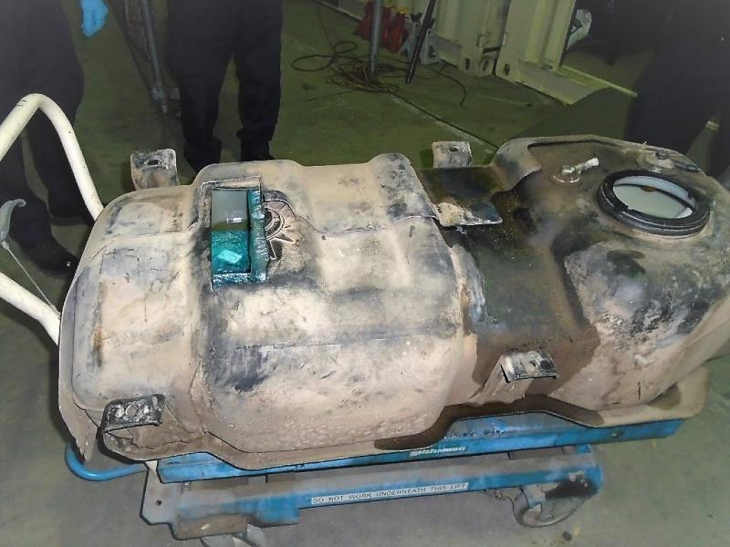 Officers removed nearly 61 pounds of meth from the fuel tank of a smuggling vehicle