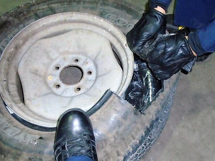 Smugglers hid heroin and meth throughout a smuggling vehicle, including within the spare tire