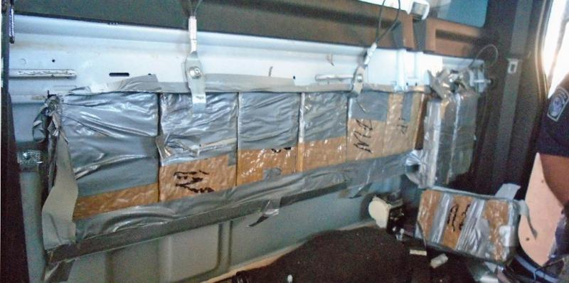 Packages of marijuana are discovered and seized by CBP officers at the Port of Naco, from within a smuggling vehicle. The packages in the photo are from behind the truck seats.