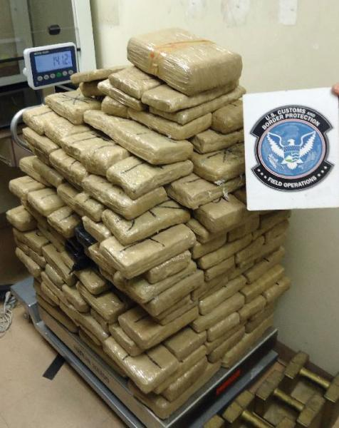 Officers removed packages of marijuana from throughout a smuggling vehicle