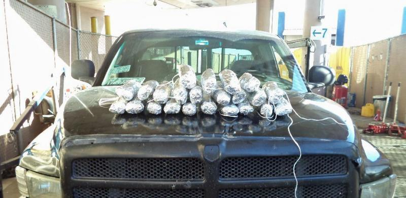 23 packages of seized drugs sitting on top of vehicle