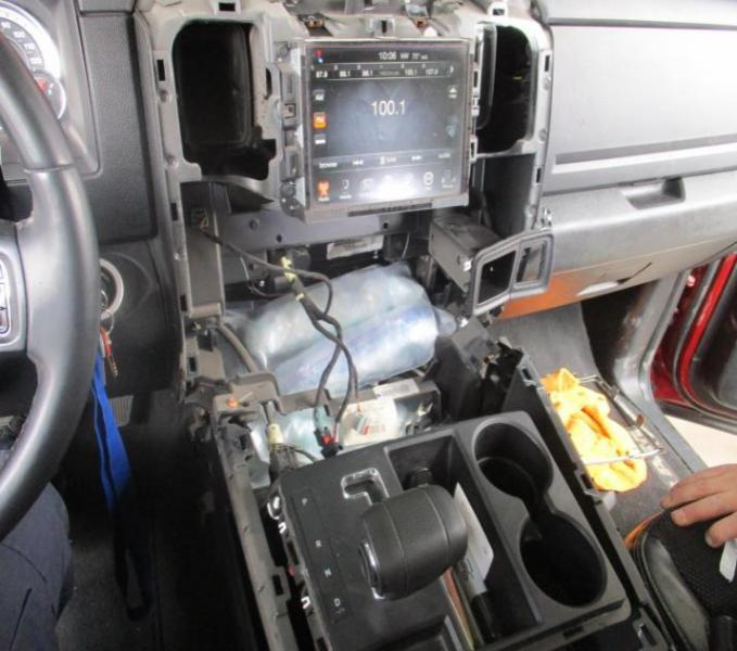 A CBP canine alerted officers to the center console, where they found drugs hidden