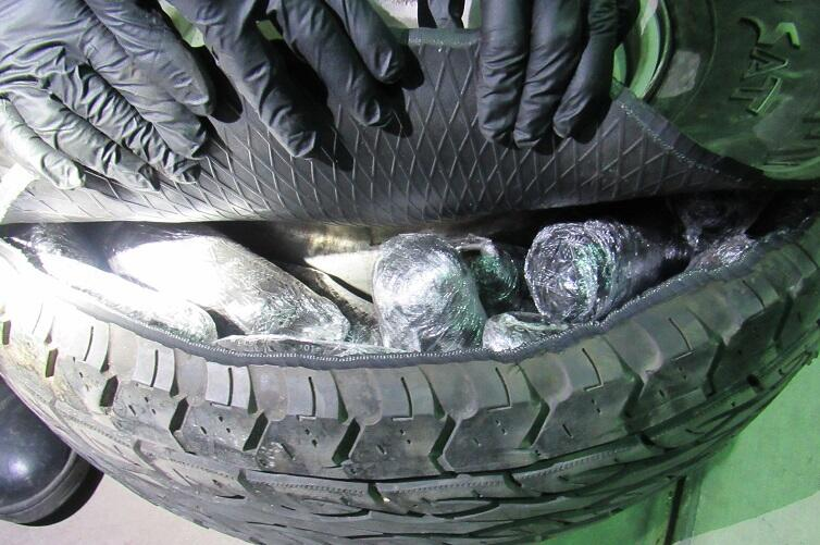 Officers removed meth from the spare tire and speaker box in the rear of a smuggling vehicle