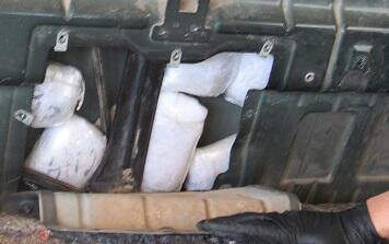 Drugs were hidden within the rear of the cab wall of a truck