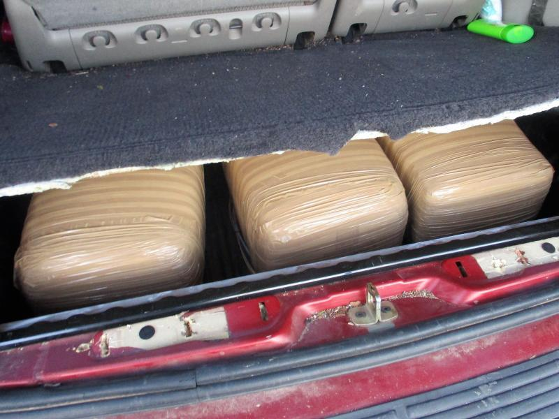 Officers discovered packages of marijuana within the rear cargo compartment