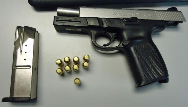 Officers seized a loaded weapon from a smuggler attempting to flee into Mexico through the port
