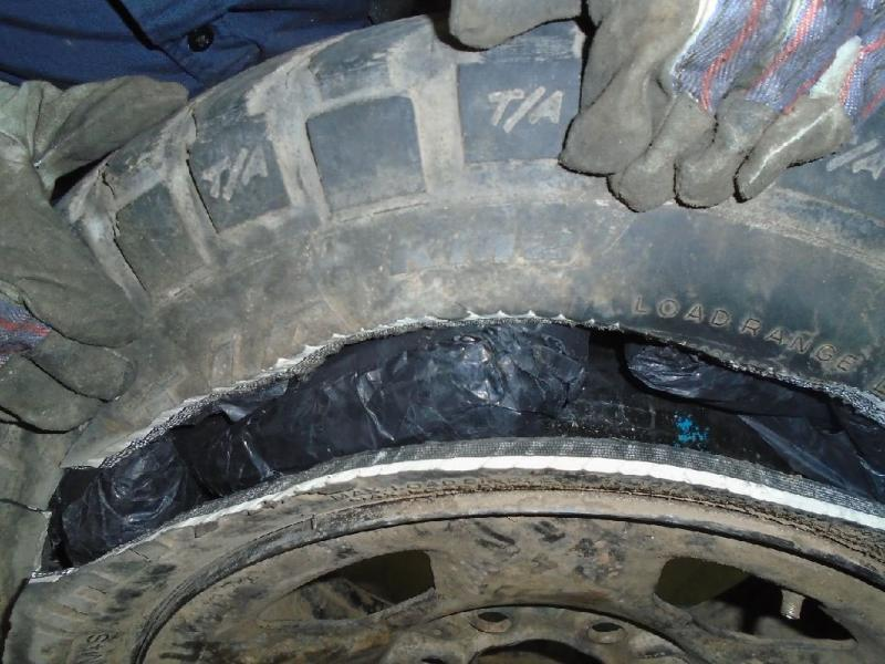 Officers removed more than 37 pounds of meth from the spare tire of a smuggling vehicle