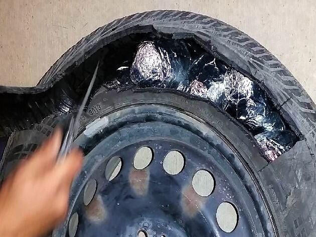 Smugglers attempted to hide packages of meth and heroin within the spare tire of a smuggling vehicle