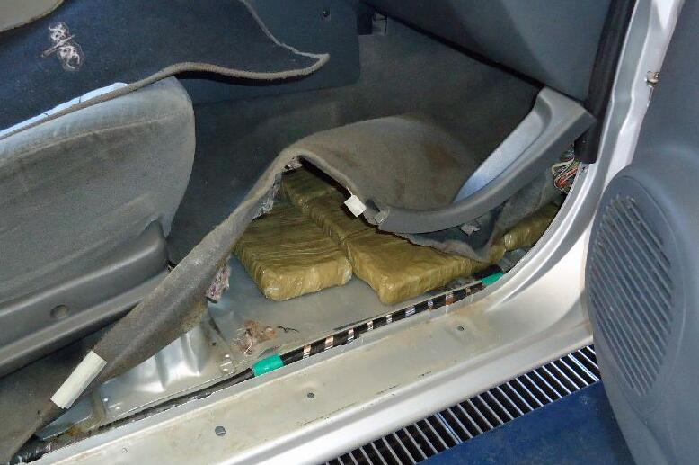 Drug smugglers attempted to conceal marijuana underneath the carpeting of a smuggling vehicle seized on Tuesday, April 20