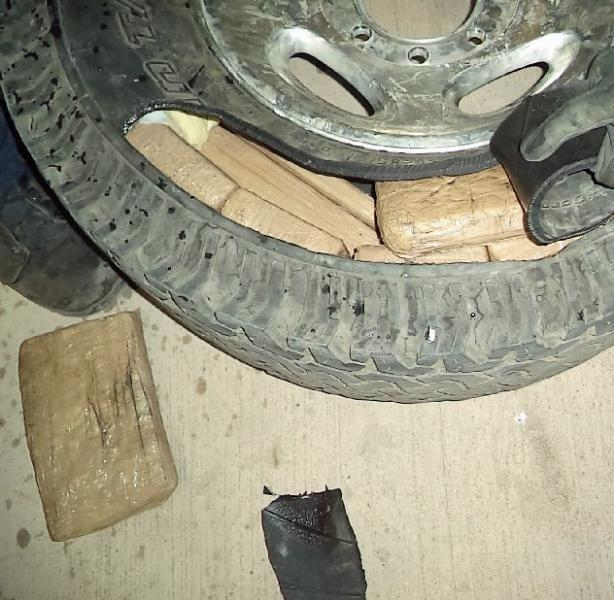 Nearly 100 pounds of marijuana was removed from one of the truck tires of a smuggling vehicle