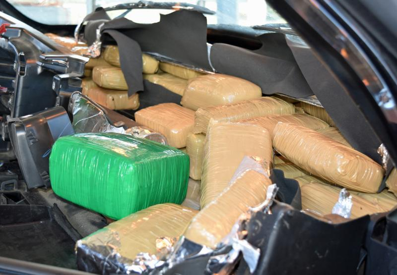 CBP officers discovered more than 200 packages of marijuana within the dashboard area of a smuggling vehicle, as well as within the floorboard.
