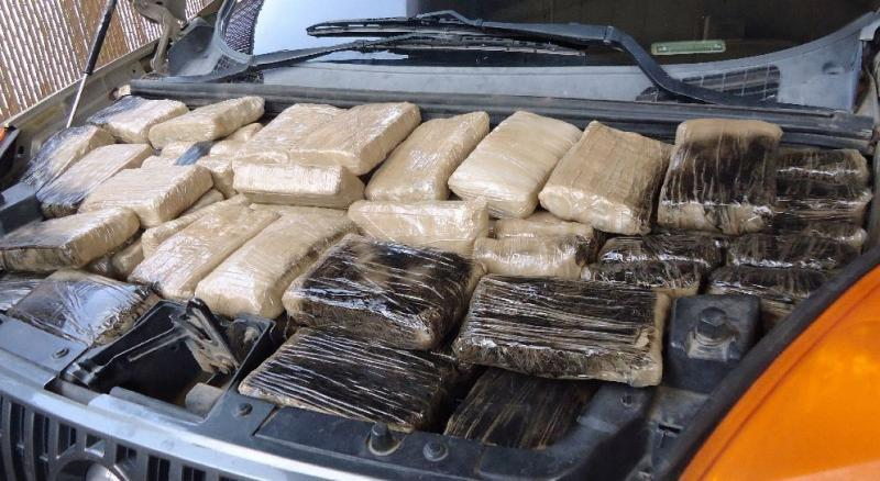 Drug smugglers attempted to hide more than 300 pounds of marijuana from officers in Douglas