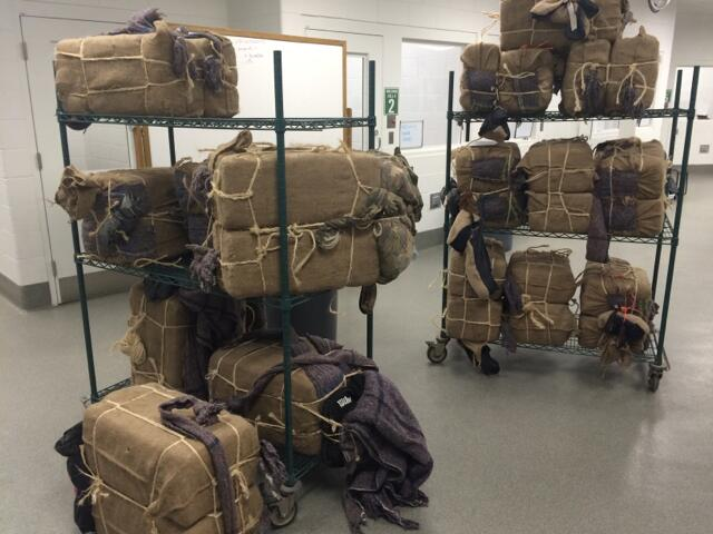 Agents seized backpacks filled with marijuana from a group of 21 individuals that were caught in eastern Yuma County