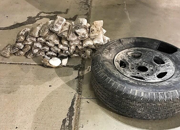 Officers discovered more than 50 pounds of meth within the spare tire of a smuggling vehicle