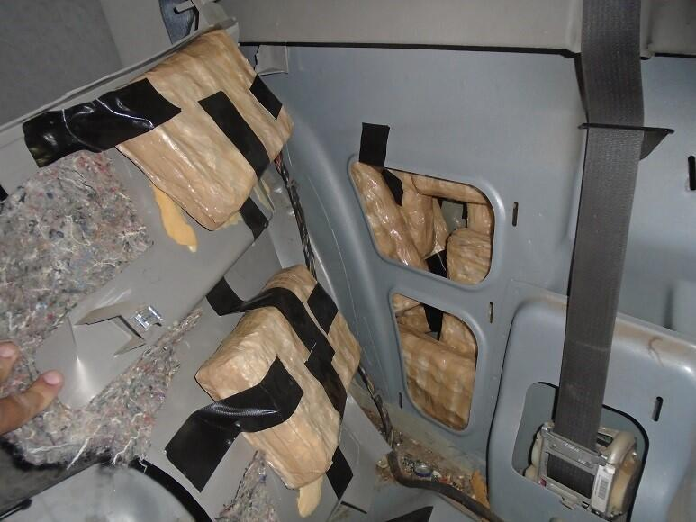 Officers located drugs throughout a smuggling vehicle