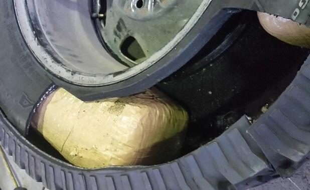 Officers removed packages of marijuana from the spare tire of a smuggling vehicle