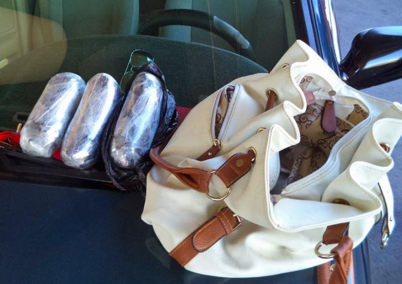 A CBP narcotics detection canine alerted to the purse of a woman referred for additional questioning, leading to the discovery of more than three pounds of meth.