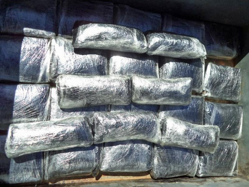 More than 114 pounds of marijuana was found within the quarter panels and the gas tank