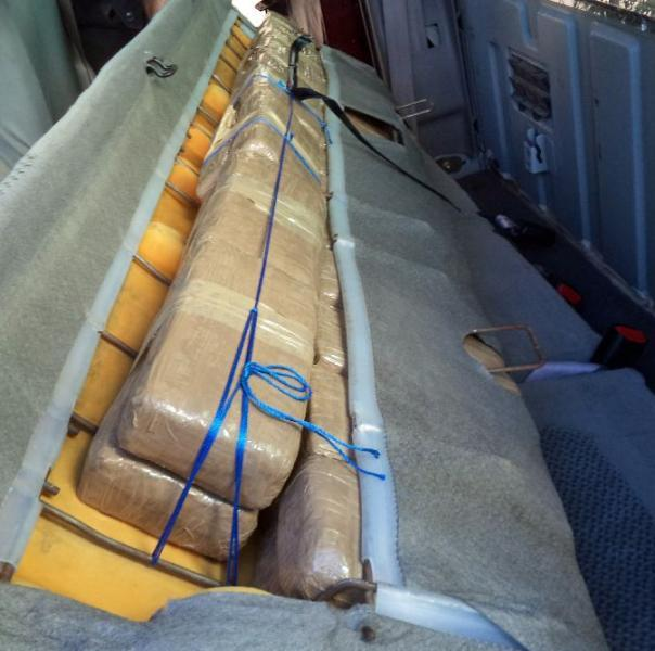 CBP officers located packages of marijuana behind the back seat of a smuggling vehicle