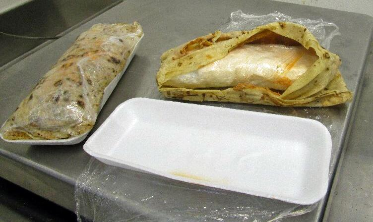 Two packages disguised as burritos where determined to be more than a pound of meth, by a CBP narcotics detection canine