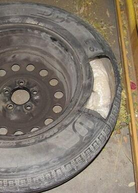 Officers discovered packages of meth within the spare tire of a smuggling vehicle