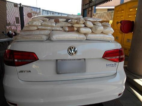 Officers aided by a CBP narcotics detection canine discovered and removed 39 pounds of meth from the center console of a Volkswagen sedan