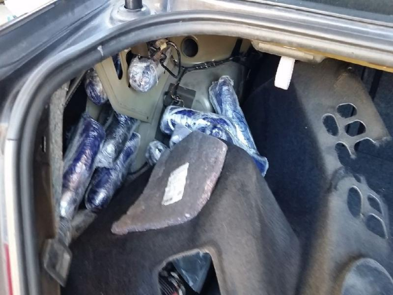 Officers removed nearly 52 pounds of meth from the trunk of a smuggling vehicle