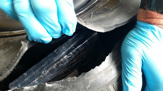 Officers removed 32 pounds of cocaine from the spare tire of a smuggling vehicle