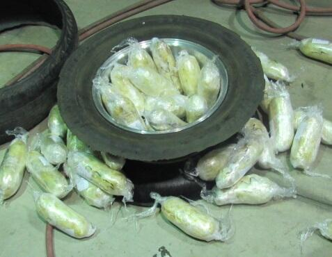 Officers discovered more than 90 packages of meth inside of a smuggling vehicle, as well as inside of the spare tire