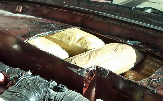 CBP officers at the Port of Nogales discovered packages of meth, behind the dashboard of a smuggling vehicle.